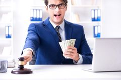 The lawyer receiving money as bribe. Lawyer receiving money as bribe Royalty Free Stock Image