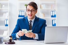 The lawyer receiving money as bribe. Lawyer receiving money as bribe Royalty Free Stock Photo