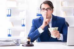 The lawyer receiving money as bribe. Lawyer receiving money as bribe Royalty Free Stock Images
