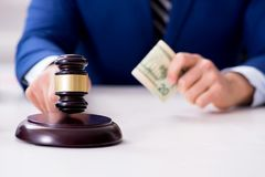 The lawyer receiving money as bribe. Lawyer receiving money as bribe Royalty Free Stock Photography