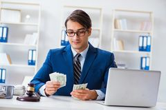 The lawyer receiving money as bribe. Lawyer receiving money as bribe stock photography