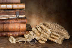 Lawyer's wig and books Stock Photos