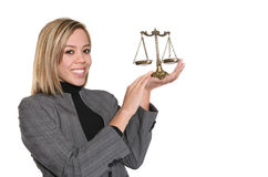 Lawyer with Scale. A layer holding a scale of justice isolated over white Royalty Free Stock Photos