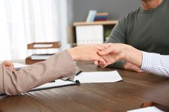 Lawyer shaking hands with client in office