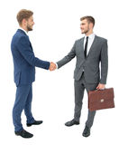Lawyer shaking hands with client welcoming him at the meeting. Closeup in  growth - the lawyer shaking hands with client.isolated on a white background. the  has Royalty Free Stock Images