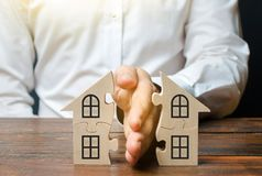 A lawyer shares a house or property between owners. Divorce concept. The division process of real estate and property