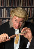 Lawyer showing evidence. Lawyer in court showing a bloody knife as evidence stock photography