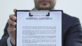 Lawyer showing marriage agreement at camera, family contract in case of divorce. Stock footage stock video