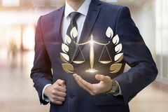 The lawyer shows the scales. royalty free stock image