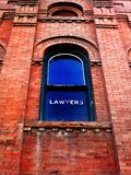 Lawyer Sign on Window Stock Photography