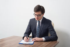 A lawyer is signing the contract. Royalty Free Stock Photo