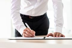 Lawyer signing an important document royalty free stock images