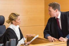 Lawyer speaking with the judge stock image