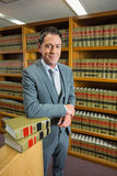 Lawyer standing in the law library Royalty Free Stock Image