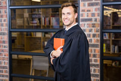 Lawyer standing near library with law book Stock Photo