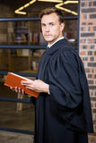 Lawyer standing near library with law book Royalty Free Stock Photography