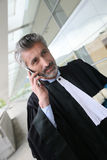 Lawyer talking on the phone in front of court Royalty Free Stock Photos