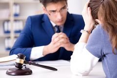 The lawyer talking to his client in office. Lawyer talking to his client in office Royalty Free Stock Photo