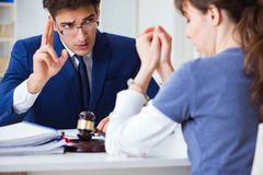 The lawyer talking to his client in office. Lawyer talking to his client in office Stock Photography