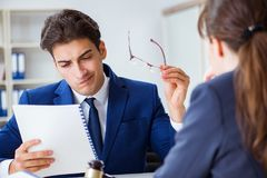 The lawyer talking to his client in office. Lawyer talking to his client in office Stock Photos