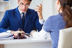 The lawyer talking to his client in office. Lawyer talking to his client in office Stock Images