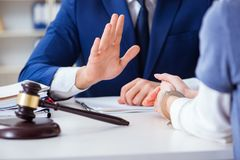 The lawyer talking to his client in office. Lawyer talking to his client in office Royalty Free Stock Photography