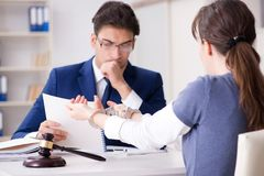 The lawyer talking to his client in office. Lawyer talking to his client in office Stock Photo
