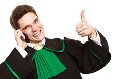 Lawyer with thumb up make a phone call. Technology and career legal advice. Young male lawyer make phone call talk help give advice with thumbs up Royalty Free Stock Image