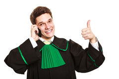 Lawyer with thumb up make a phone call. Technology and career legal advice. Young male lawyer make phone call talk help give advice with thumbs up Royalty Free Stock Photos