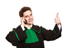 Lawyer with thumb up make a phone call. Royalty Free Stock Photography