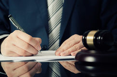 Lawyer working with agreement in office. Man signing hand writing pen attorney concept royalty free stock images