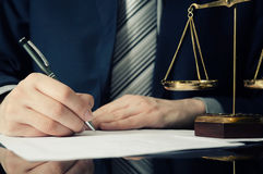 Lawyer working with agreement in office. Man signing hand writing pen attorney concept royalty free stock photography