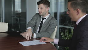 The lawyer working with the client. Time to sign the contract. Men in suits examine the documents stock video