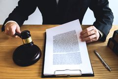 Lawyer working with contract papers on the table in office. cons stock image