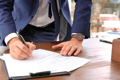 Lawyer working with documents at table. Focus on hands royalty free stock photography