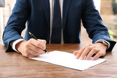 Lawyer working with documents at table stock photos
