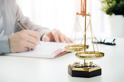 Lawyer working in the office. Lawyer law attorney scales office justice person concept stock image
