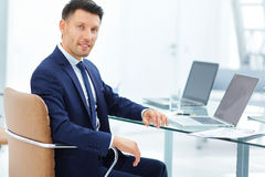 Lawyer in the workplace on a light background Royalty Free Stock Photo