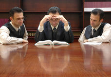Lawyers. Clones of lawyer reading criminal law book Royalty Free Stock Photos