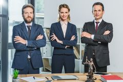 Lawyers with arms crossed stock images