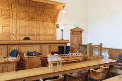 Lawyers bench in courtroom. View of a courtroom with judge`s chair, lawyers benches and witness stand royalty free stock photo