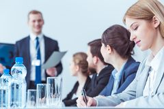 Lawyers during company meeting. Elegant business lawyers writing during company board meeting Stock Photo