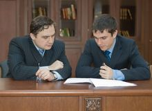 Lawyers consider the contract Stock Photo