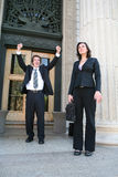 Lawyers at Court. Two lawyers celebrating a success outside of court Stock Photo
