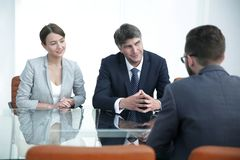 Lawyers discuss the contractual agreement. Concept of partnership. jurists are discussing a contractual agreement Royalty Free Stock Photo