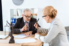 Lawyers discussing contract Stock Photos