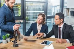 Lawyers discussing contract in office Royalty Free Stock Photo