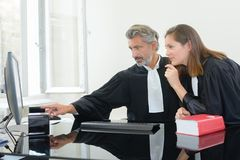 Lawyers examining an evidence. Lawyer stock photography