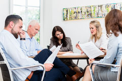 Lawyers having team meeting in law firm. Reading documents Royalty Free Stock Photo
