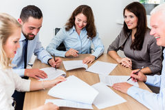 Lawyers having team meeting in law firm. Reading documents and negotiating agreements Stock Photography